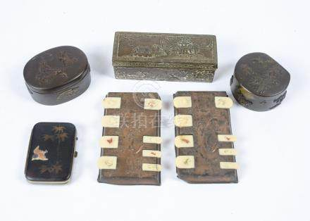 A pair of late 19th Century Japanese copper and ivory whist markers, 9.5 cm wide; together with