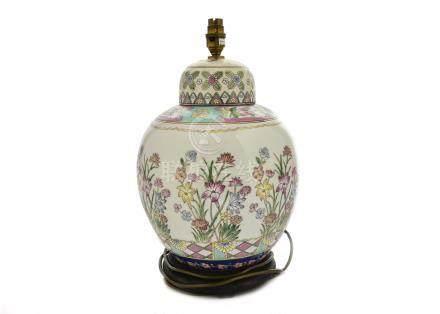 A Chinese famille rose porcelain lamp base, floral decoration, wooden base, 42 cm high including