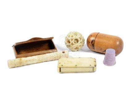 A Meiji period carved ivory puzzle ball, together with an ivory string holder, a wooden vesta
