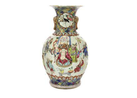 A late Qing period porcelain famille rose baluster vase, twin elephant head handles, body with