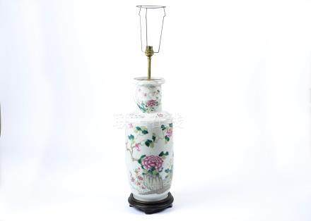 A large late 19th Century Chinese famille rose baluster vase, converted to a lamp, decorated with