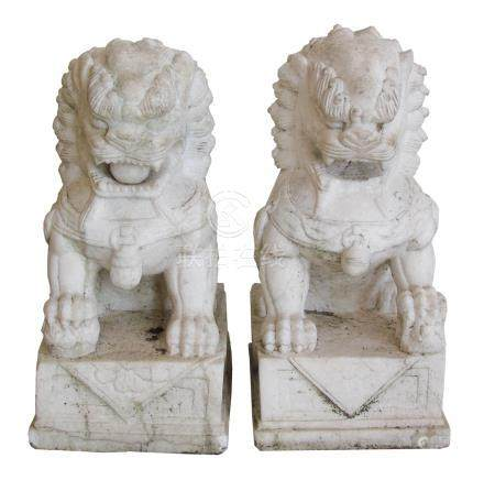 "20th century Chinese pair of white marble Guardian Lions, height 53cm (21"")."