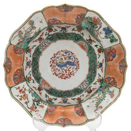 A Chinese famille verte lotus form dish: finely painted with a mythical beast to the centre within