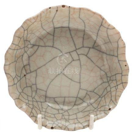 A Chinese crackle glazed brush washer: of mallow form in Song Dynasty style, 12 cm diameter.