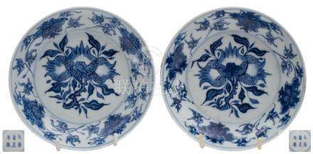 A pair of Chinese blue and white pomegranate saucer dishes: painted with bunches of pomegranates