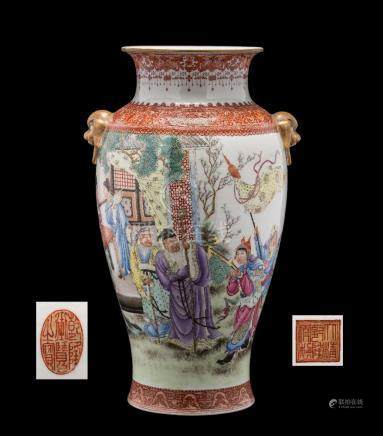 A Chinese famille rose baluster vase: with gilt lion dog ring handles,