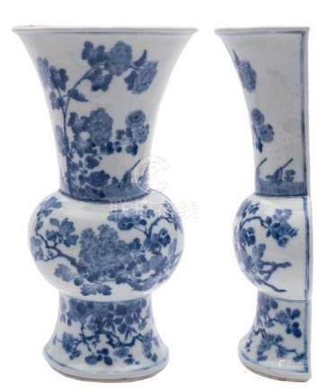 A Chinese blue and white wall vase: of rounded baluster half-section, painted with two birds, peony,