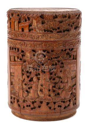 A Chinese carved bamboo cylindrical box and cover: carved overall with figures on terraces, phoenix,