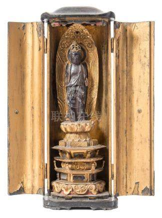 A 19th century Chinese carved gilt wood shrine figure: possibly Guan Yin,