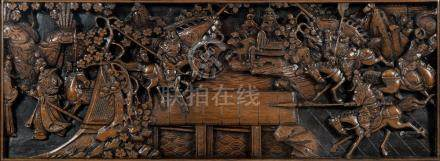 A Chinese carved wood panel: depicting mounted figures charging towards a bridge,