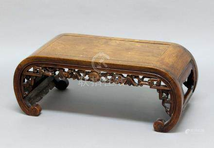 CHINESE HARDWOOD LOW TABLE, the rounded top above an apron carved with a central mon surrounded by