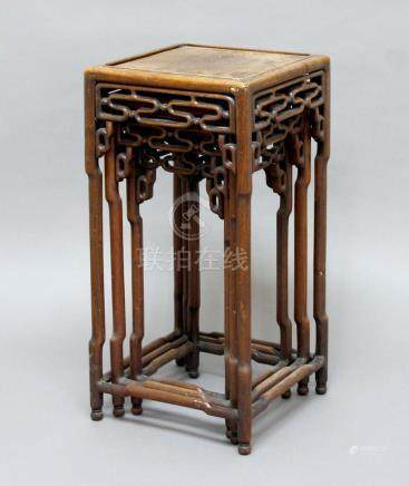 CHINESE HARDWOOD NEST OF THREE TABLES, 19th century, with pierced aprons and shaped legs, height