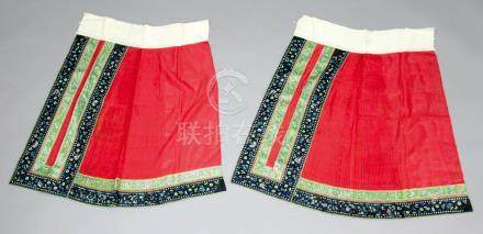 CHINESE EMBROIDERED SILK SKIRT, late 19th century, in two sections, in red with panels of embroidery