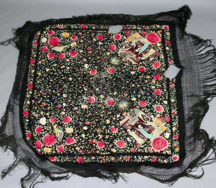 CHINESE EMBROIDERED SILK SHAWL, worked in silks with figures outside a pavillion and surrounded by