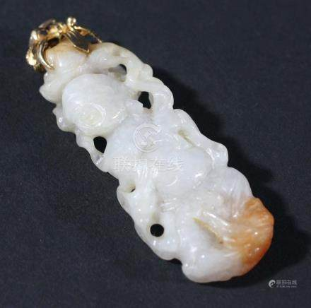CHINESE WHITE AND RUSSET JADE PENDANT, carved as a man holding a fruiting peach branch, with gold