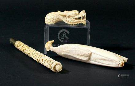 CHINESE IVORY PARASOL HANDLE, 19th century, carved in the canton style with dragons amongst foliage,