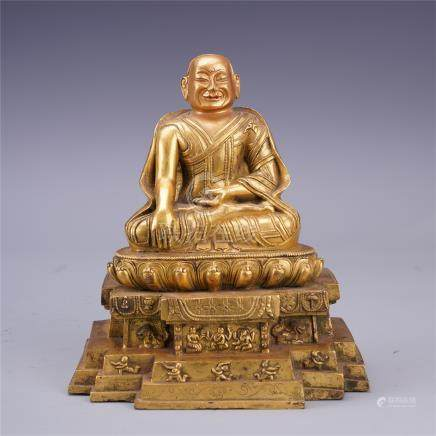 TIBETAN GILT BRONZE SEATED GURU
