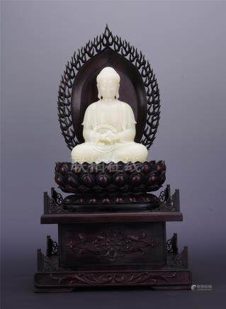 CHINESE YELLOW JADE SEATED BUDDHA ON ROSEWOOD STAND