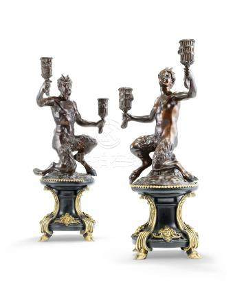 A PAIR OF LOUIS XIV ORMOLU-MOUNTED, PATINATED BRONZE AND EBONISED SATYR TWO-LIGHT CANDELABRA