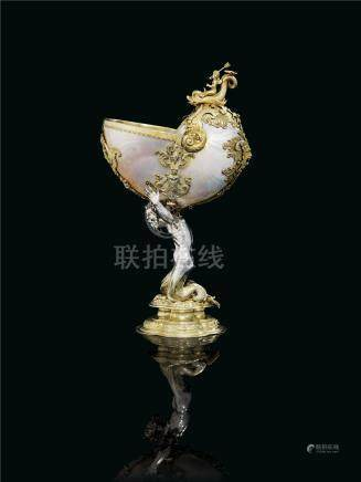 A GERMAN PARCEL-GILT SILVER-MOUNTED NAUTILUS SHELL CUP