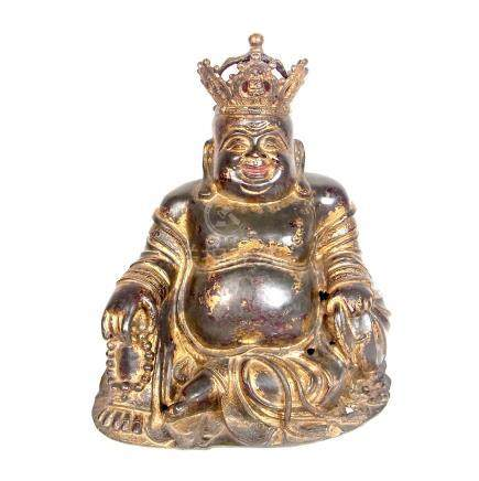 A Chinese gilt bronze figure of Budai, Ming Dynasty, probably 16th century.