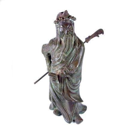 A large Chinese bronze figure of an immortal warrior.