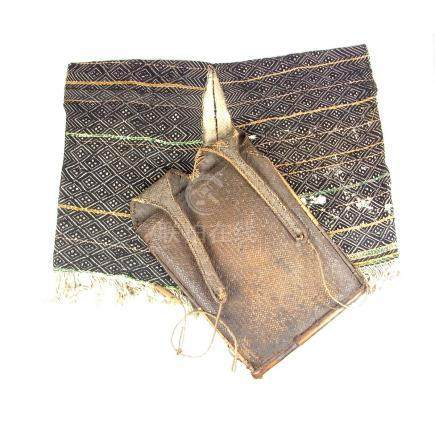 A Tribal Textile Naga Apatani jacket and haversack basket, India or Burma, circa 1920.