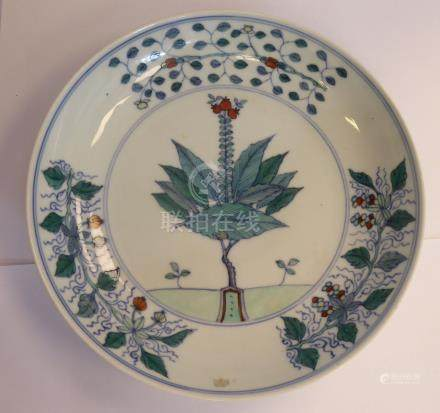 An 18thC Chinese porcelain Doucai dish, decorated with a central flowering plant,