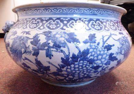 A mid 19thC Chinese porcelain jardiniere of squat, bulbous form, having a flared rim and opposing,