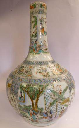 A late 19thC Chinese porcelain bottle vase of bulbous form with a long slender neck,