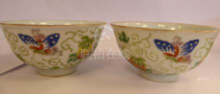 A pair of late 19thC Chinese porcelain bowls, decorated with fruit,