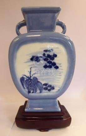 A mid 20thC Chinese porcelain vase of shouldered box design with opposing loop handles,