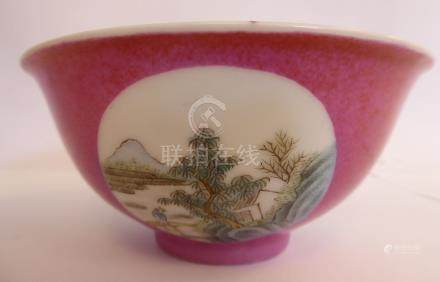 A mid 20thC Chinese porcelain bowl, decorated in panels with landscapes,