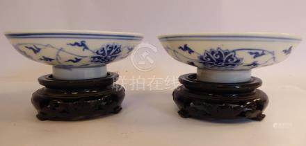 A pair of late 19thC Chinese porcelain footed bowls,