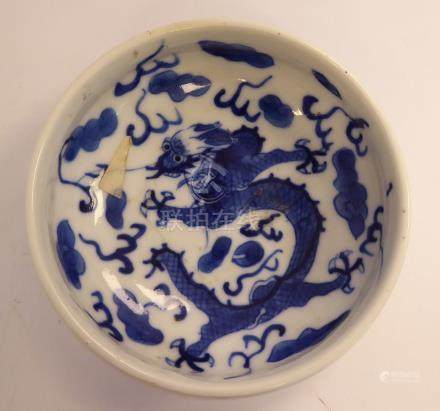 A late 19thC Chinese porcelain shallow bowl, decorated with a dragon and cloud motifs 3.