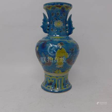 A Chinese, Ming-style blue glazed vase hand decorated with figures on a terrace and floral motifs,