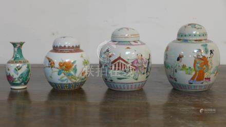 Three Chinese porcelain and hand-enamelled ginger jars, H: 12cm, 12cm and 10cm with a miniature vase