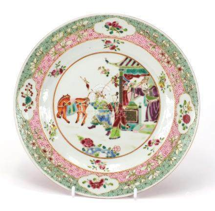 Chinese porcelain plate finely hand painted in the famille rose palette with figures within a