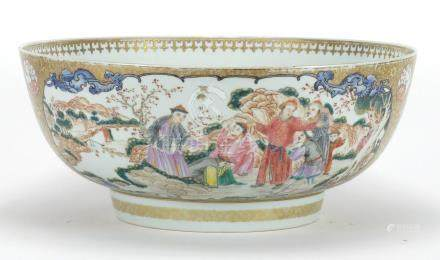 Chinese porcelain punch bowl, finely hand painted in the famille rose palette with panels of figures