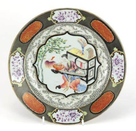 Chinese porcelain plate finely hand painted in the famille rose palette with a musician, 23cm in