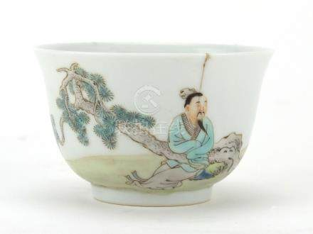 Chinese porcelain tea bowl, finely hand painted with a figure beside a pine tree and a crane, blue