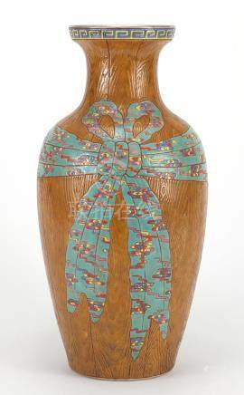 Chinese porcelain naturalistic vase, hand painted in the famille rose palette with a ribbon, four