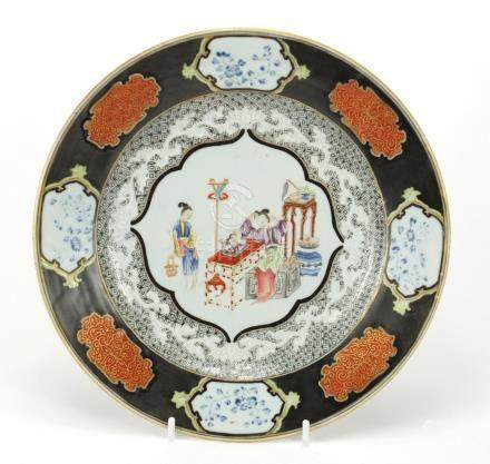 Chinese porcelain plate finely hand painted in the famille rose palette with two females, 23.5cm
