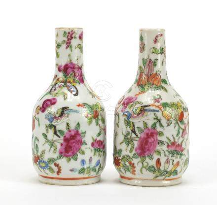 Pair of Chinese porcelain Canton vases, hand painted in the famille rose palette with birds of