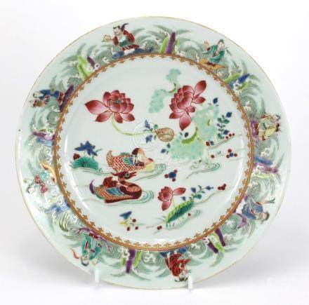 Chinese porcelain plate finely hand painted in the famille rose palette with ducklings amongst