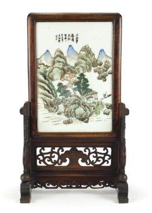 Chinese hardwood table screen housing a porcelain panel hand painted with figures in a river