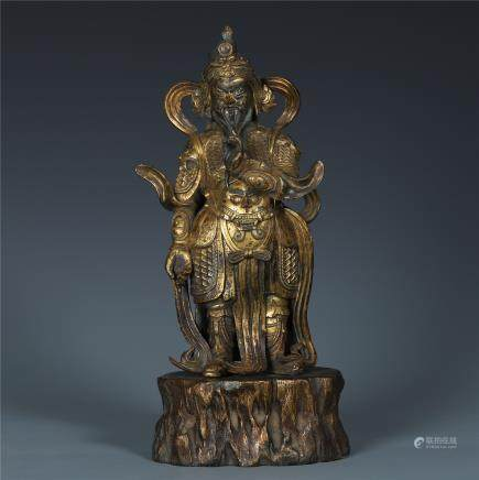 A Chinese Gilt Bronze Standing Figure of the God of Wealth