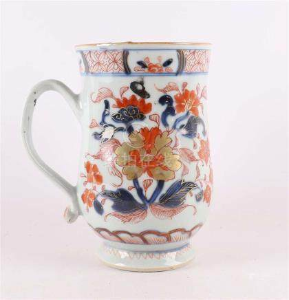 A Chinese Imari porcelain beer mug with an ear on a stand ri