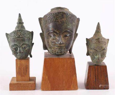 A series of three bronze Buddhas on wooden base, India, 18th