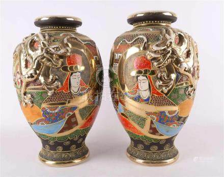 A set of Satsuma earthenware vases with dragons as handles,